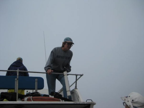 Patricia Walsh Leans Down from the Flying Bridge to Talk with The Captain