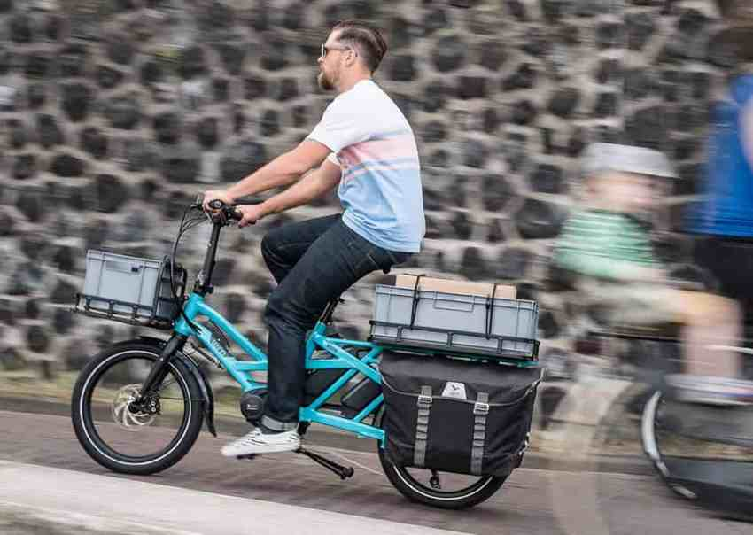 Easy E-Biking - man riding loaded cargo e-bike, helping to make electric biking practical and fun