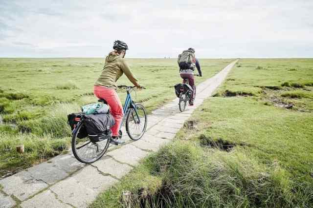 Easy E-Biking - a couple riding e-bike in the nature, helping to make electric biking practical and fun