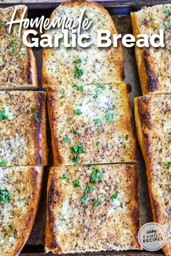 Homemade Garlic Bread Sliced on Baking Sheet