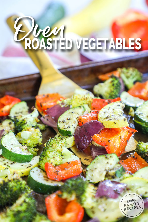 Oven Roasted Vegetables on a spatula including red pepper, zucchini, Squash, and broccoli