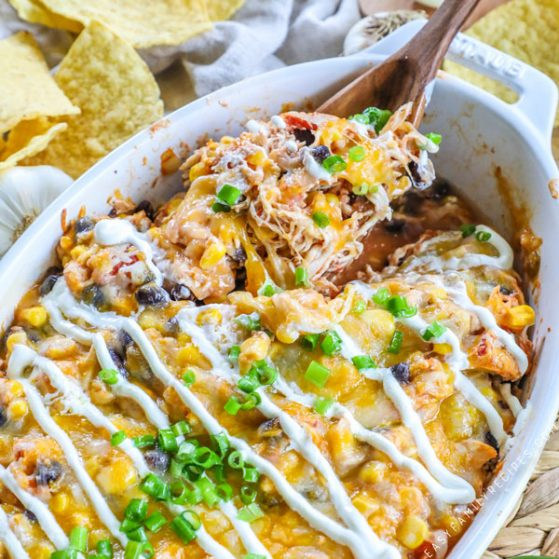 Mexican Chicken in Casserole dish drizzled with sour cream