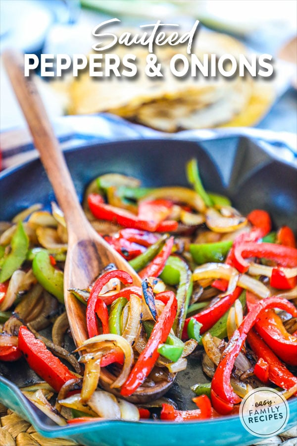 spooning out a serving of sautéed bell peppers and onions