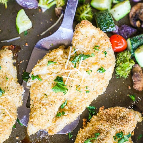 Healthy Baked Chicken Cutlet being lifted from the pan with a spatula