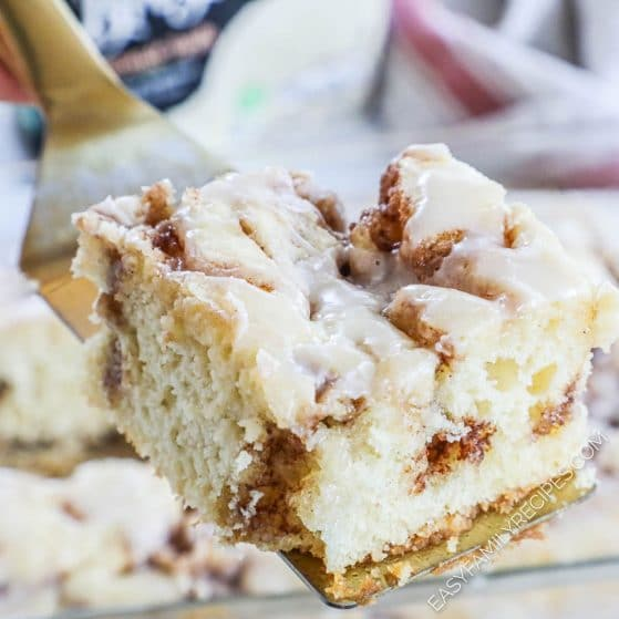 slice of cinnamon swirl cake showing the cinnamon swirl in the middle of the vanilla cake