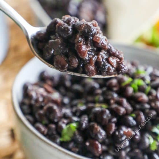 Spoonful of black beans made from scratch in the crock pot