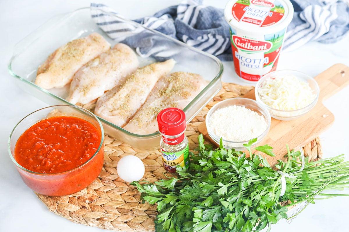 Ingredients for making Lasagna Chicken - Chicken breast, tomato sauce, seasonings, parsley, ricotta cheese, egg, mozzarella cheese