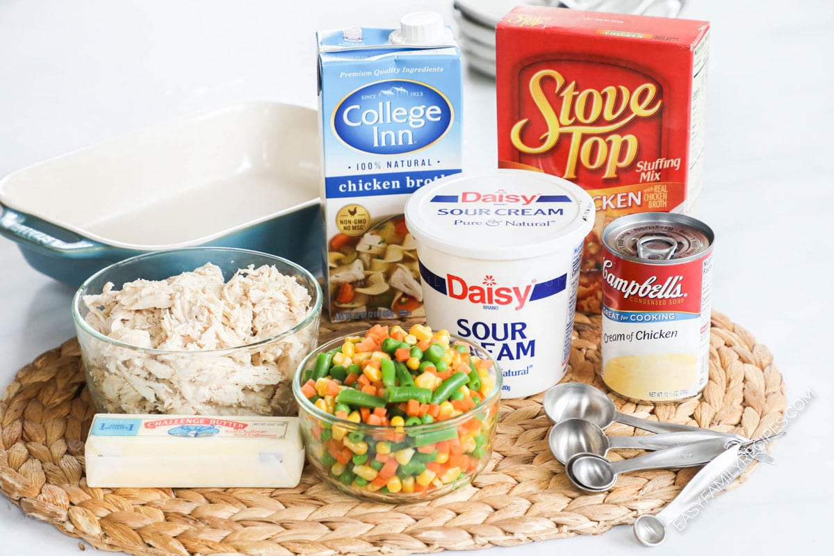 Ingredients for Chicken Stuffing Casserole including chicken breast, stove top stuffing, sour cream, cream of chicken soup, chicken broth, and vegetables