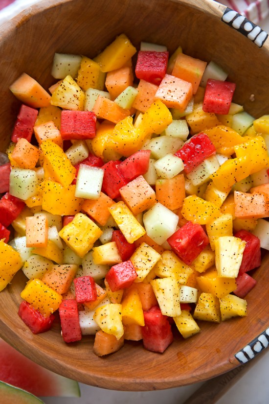 A simple Mexican fruit salad that's spiced up! I toss my favorites – watermelon, honeydew, pineapple, cantaloupe and of course, mangoes in a light honey-lime and chili flavored dressing! This is the perfect refreshing and healthy treat for all your summer gatherings!