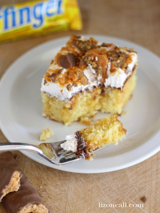 Butterfinger Cake uses a boxed cake mix made according to the directions,  with butterscotch, chocolate pudding, whipped topping and crushed up butterfinger candy bars.