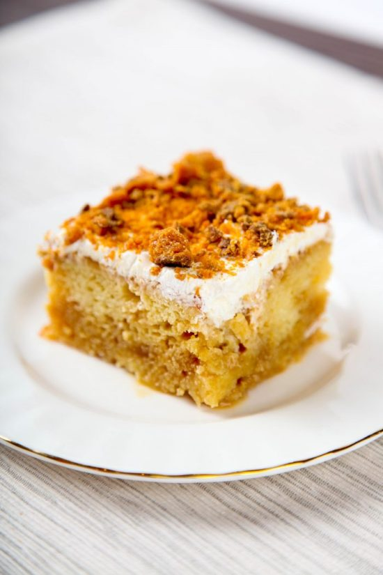 Butterfinger Poke Cake is so luscious, but only 5 ingredients! Easy to make and even easier to eat!