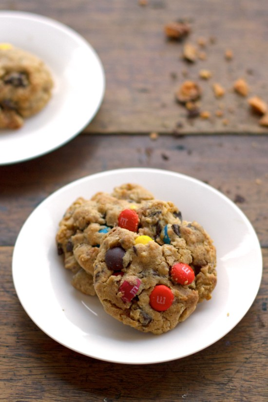 These Butterfinger monster cookies are so addicting! Made with peanut butter, M&Ms, and crushed Butterfinger candy bars. YUM.