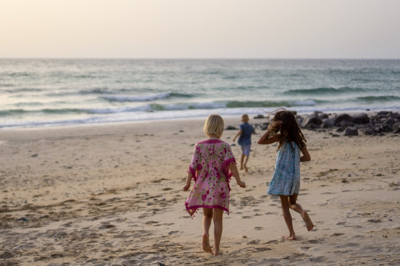 Wild beach in Oman, kids