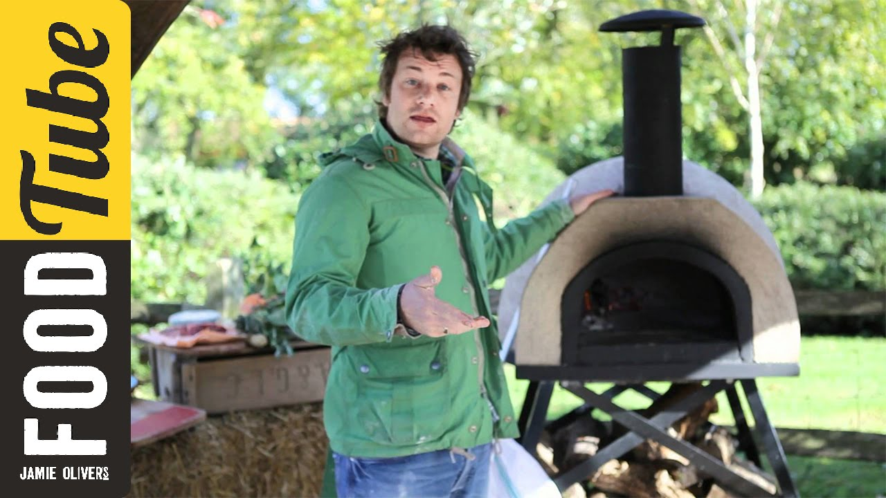 Jamie Oliver shows you how to cook pizza in a wood fired oven (VIDEO)