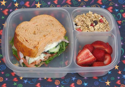 Panera for dinner last night, so leftovers for lunch today! Half of a Mediterranean Veggie sandwich - tomato, onion, cucumber, lettuce, peppers, feta and hummus. On the side are strawberries and yogurt with granola on top. Thanks to Bento For Kidlet for sharing this one.   http://bit.ly/bvLF6t