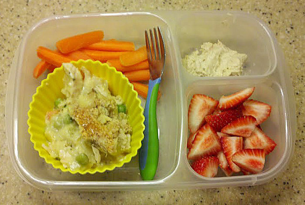 Cody's lunch (made by Jennie) includes leftover chicken pot pie, carrot sticks and hummus, & strawberries. Thanks to Jennie and Kim from Surviving Motherhood for sharing.