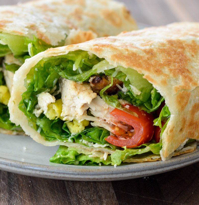 Try these easy Italian Chicken Wraps loaded with grilled chicken, lettuce, peppers, tomatoes, parmesan and zesty Italian dressing! This is an easy, healthy wrap recipe perfect for lunch or dinner!