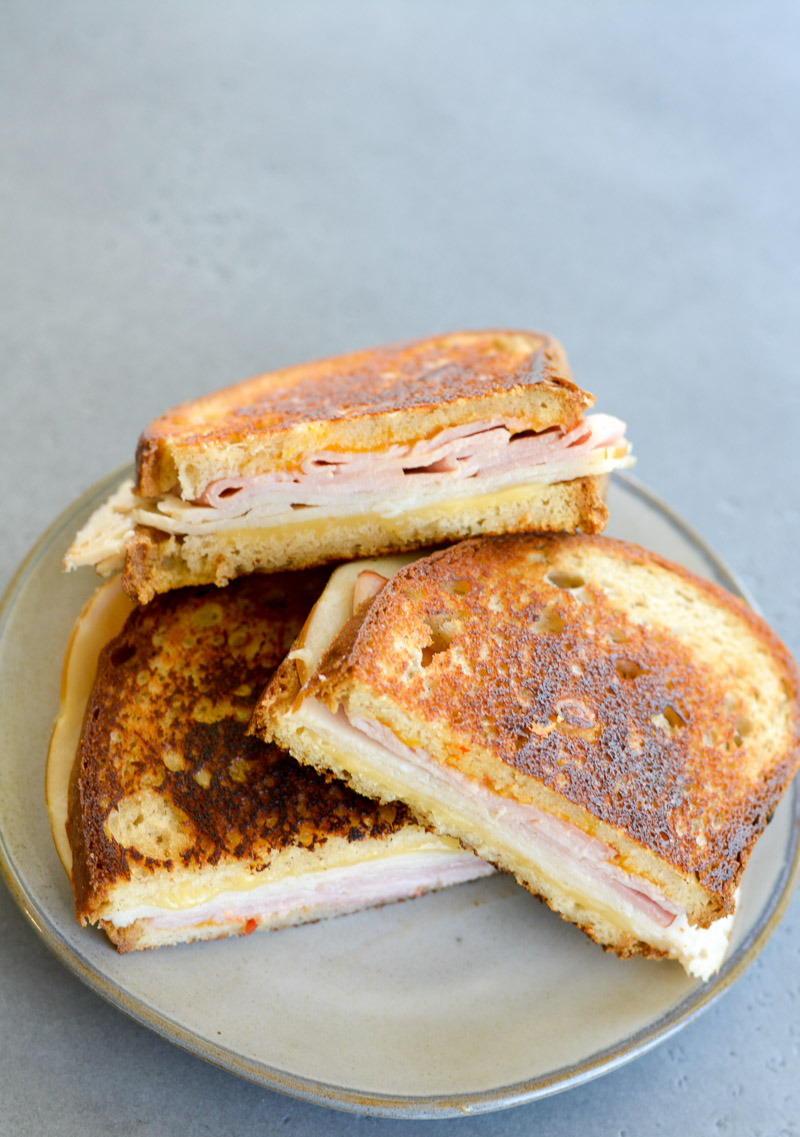 This Ham, Turkey and Gouda Panini is loaded with deli meat, melted cheese and a spicy chipotle sauce! This quick and easy panini recipe can be made in under 10 minutes for a quick lunch or dinner!