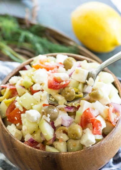 Refreshing Cucumber Salad is loaded with fresh vegetables and perfect for all of your summer cookouts!