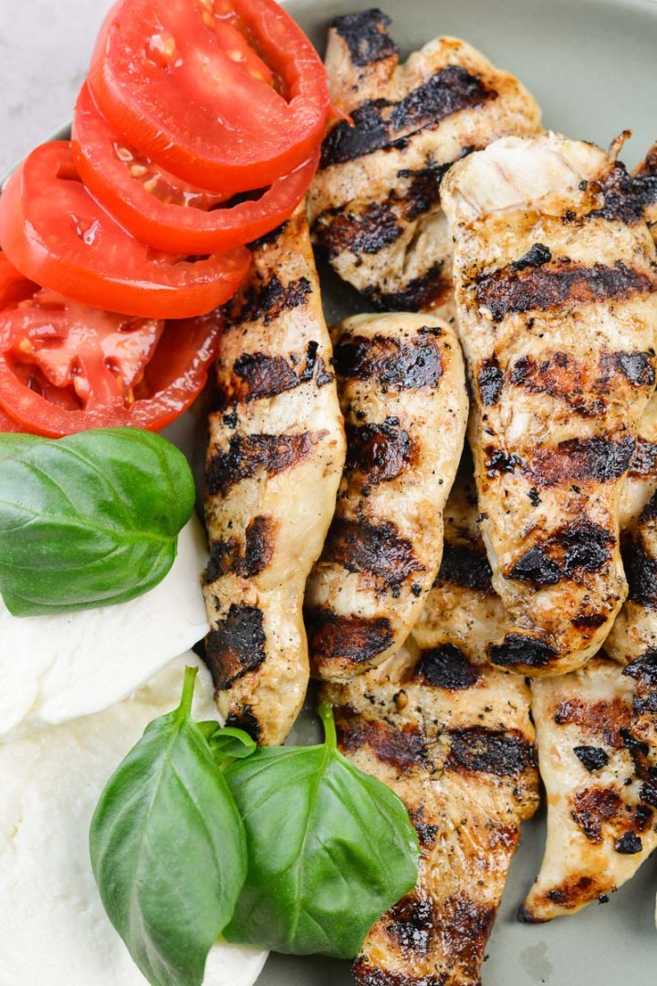 This quick and easy Balsamic Grilled Chicken is perfect paired with tomatoes and mozzarella or used in your favorite wraps!