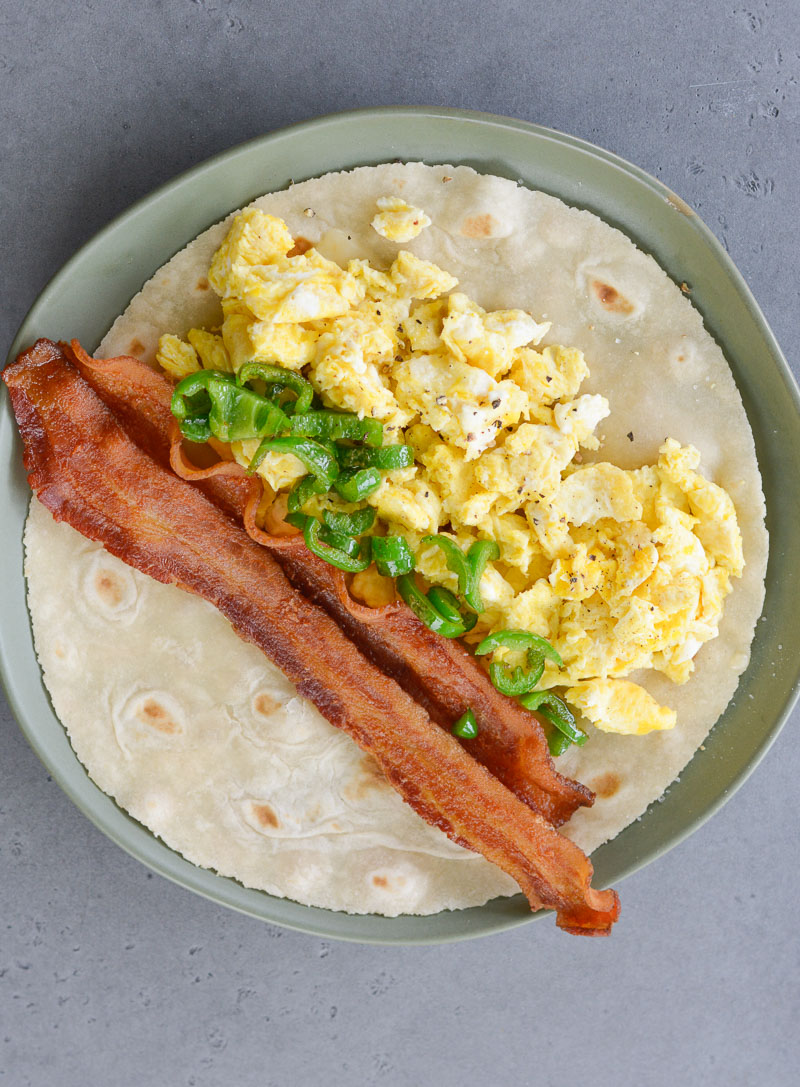 This quick and easy Bacon Egg and Jalapeno Breakfast Burrito is loaded with scrambled eggs, spicy pepper jack cheese, crispy bacon and sautéed jalapeño peppers!