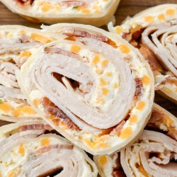 Combine a few basic ingredients to make these delicious Turkey Bacon Ranch Pinwheels! This easy recipe makes a great appetizer or lunch that can be made gluten free and low carb!