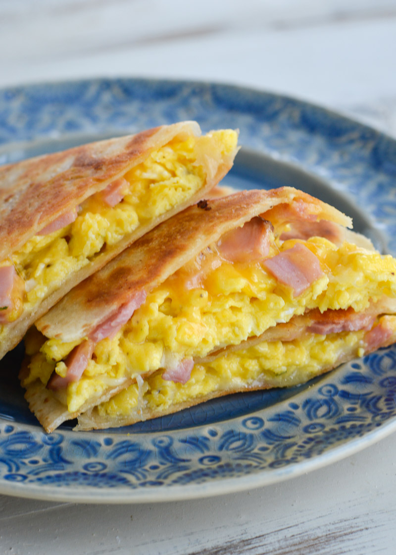 Ham Egg and Cheese Quesadillas are the ultimate 15 minute meal! Packed with scrambled eggs, two kinds of cheese and chunks of savory ham, this is will be a new family favorite!