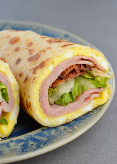 This Loaded Egg Wrap is packed with two kinds of meat, cheese, veggies and a tangy sauce!