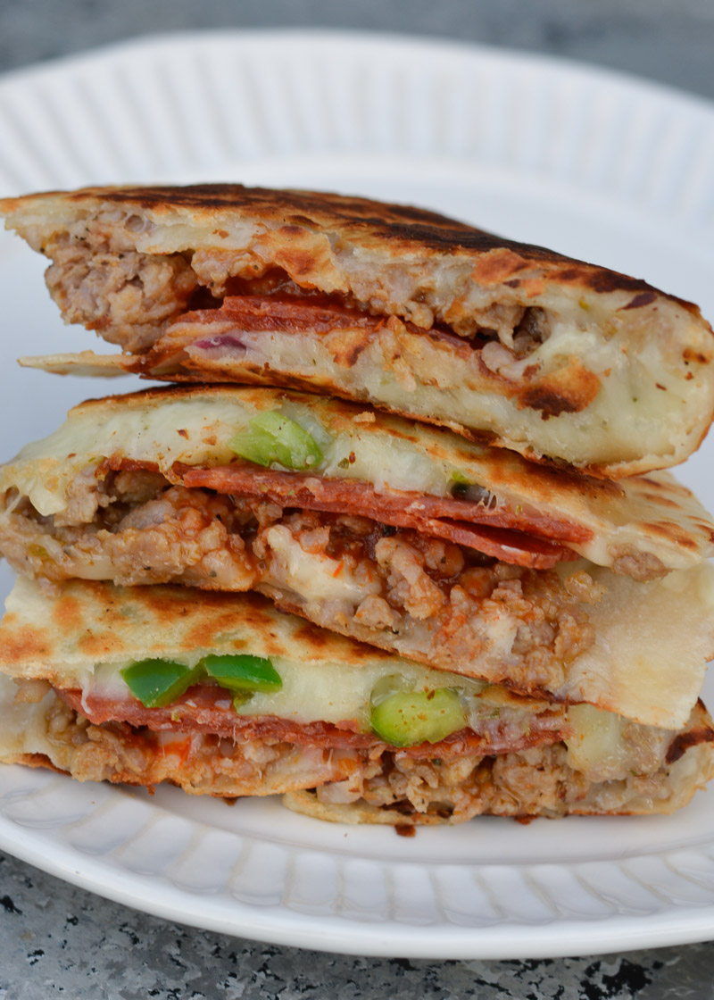 If you want an easy, super-filling, quick meal, this Supreme Pizza Quesadilla is the answer! It's fully loaded with all your favorite pizza toppings and stuffed with delicious cheese!
