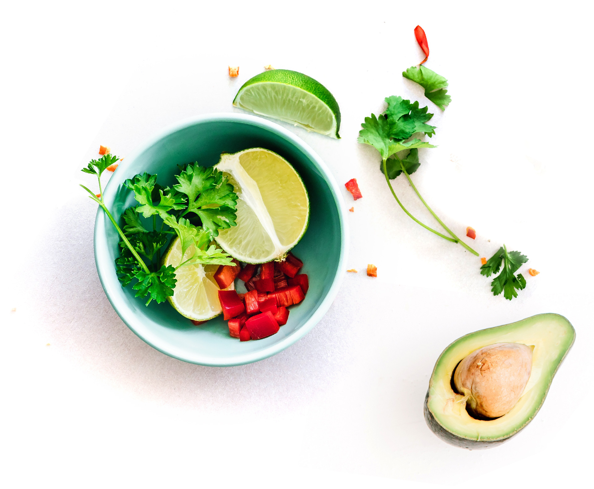 avocado greens lemon and vegetable in a bowl