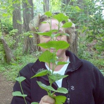 My mom hiding behind garlic mustard.