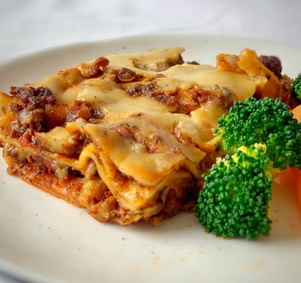 Beef lasagne on white plate