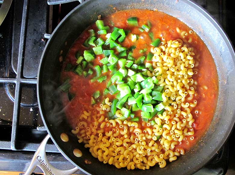 """Bacon-Cheeseburger Skillet Pasta   eatatkates.com - No """"helper"""", not even a pot of boiling water, is needed for this delicious skillet pasta. Ground turkey, bacon, tomato, seasonings, and melty american cheese come together for a delicious weeknight meal."""