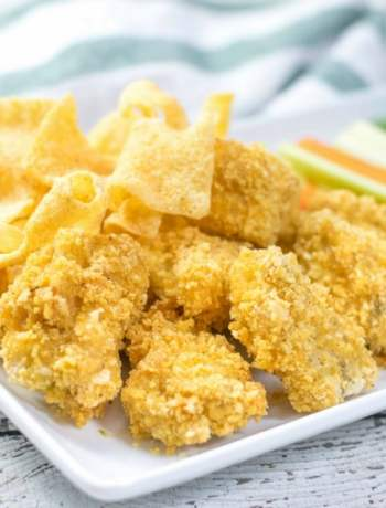 close up of boneless chicken wings with plentils