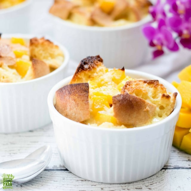 gluten free mango bread puddings in individual white ramekins