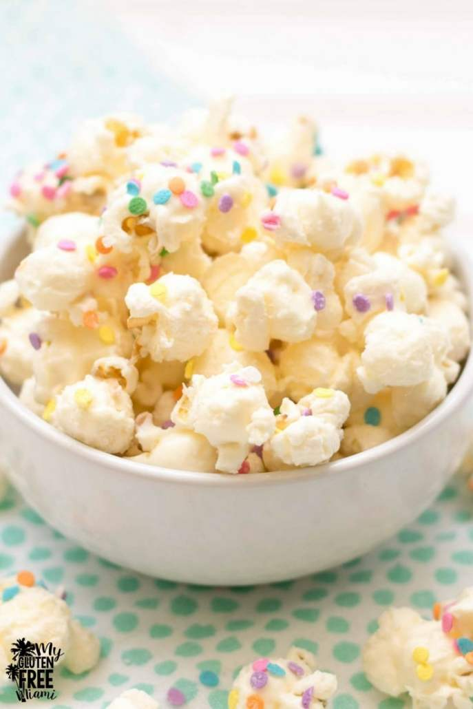 white chocolate popcorn with colored sprinkles in a bowl