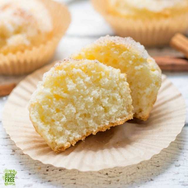 Gluten Free Donut Muffins cut open to see soft and fluffy inside.