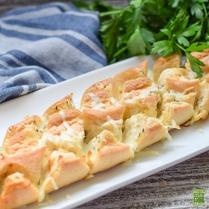 gluten free pull apart cheesy bread on white tray