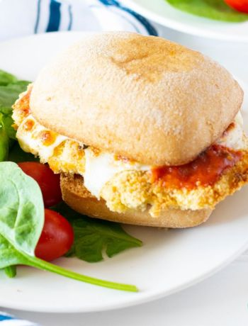 gluten free chicken parmesan sandwich ona plate