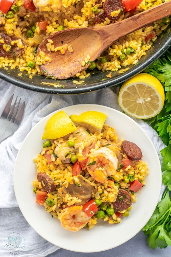 Over head of Gluten Free Paella Mixta on a plate with paella pan