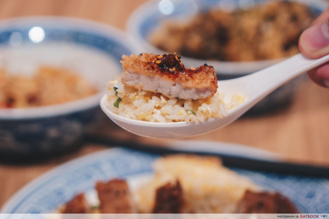 Feng Food fried rice with specialty marinated pork chop scoop