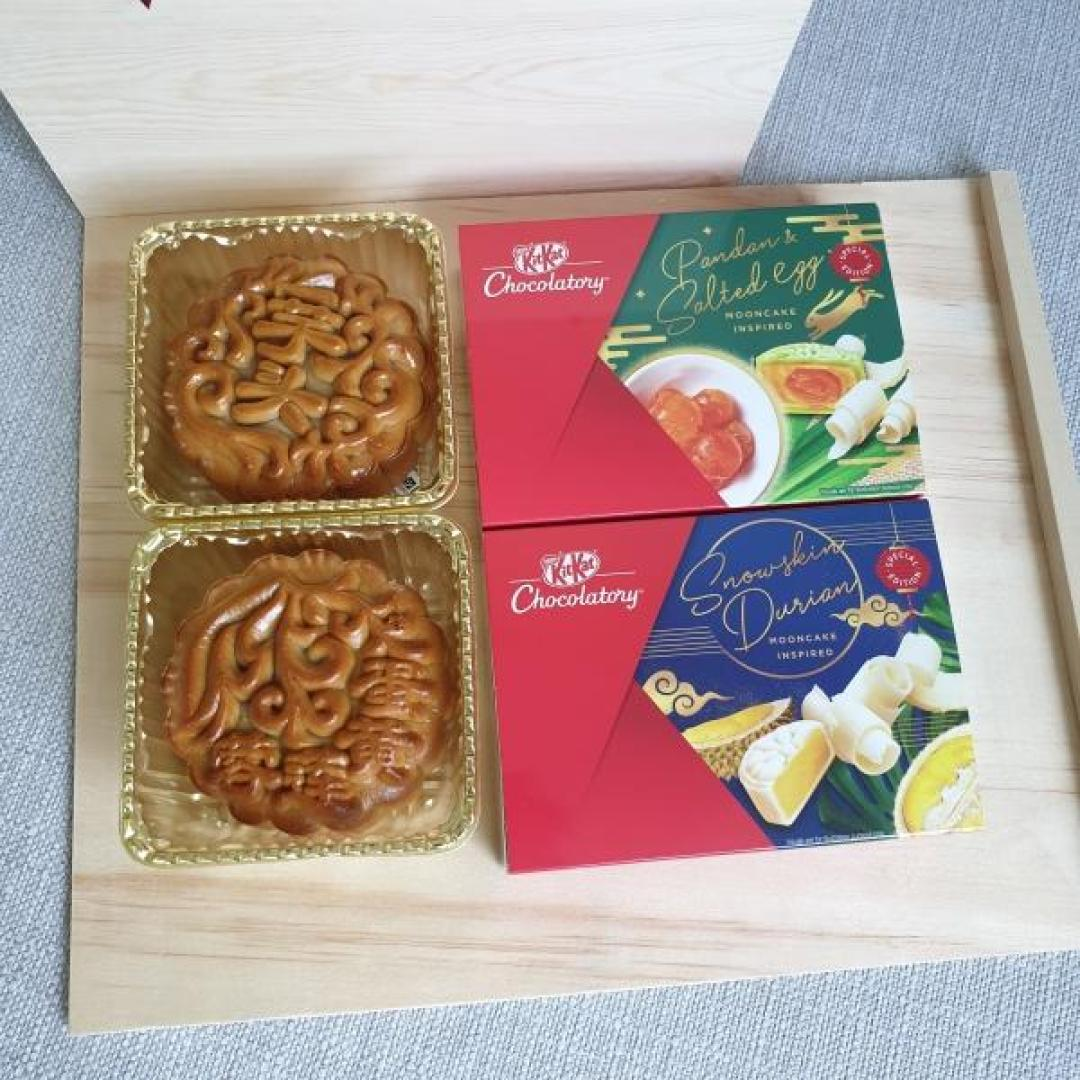 Boxes of mooncakes and KiKat