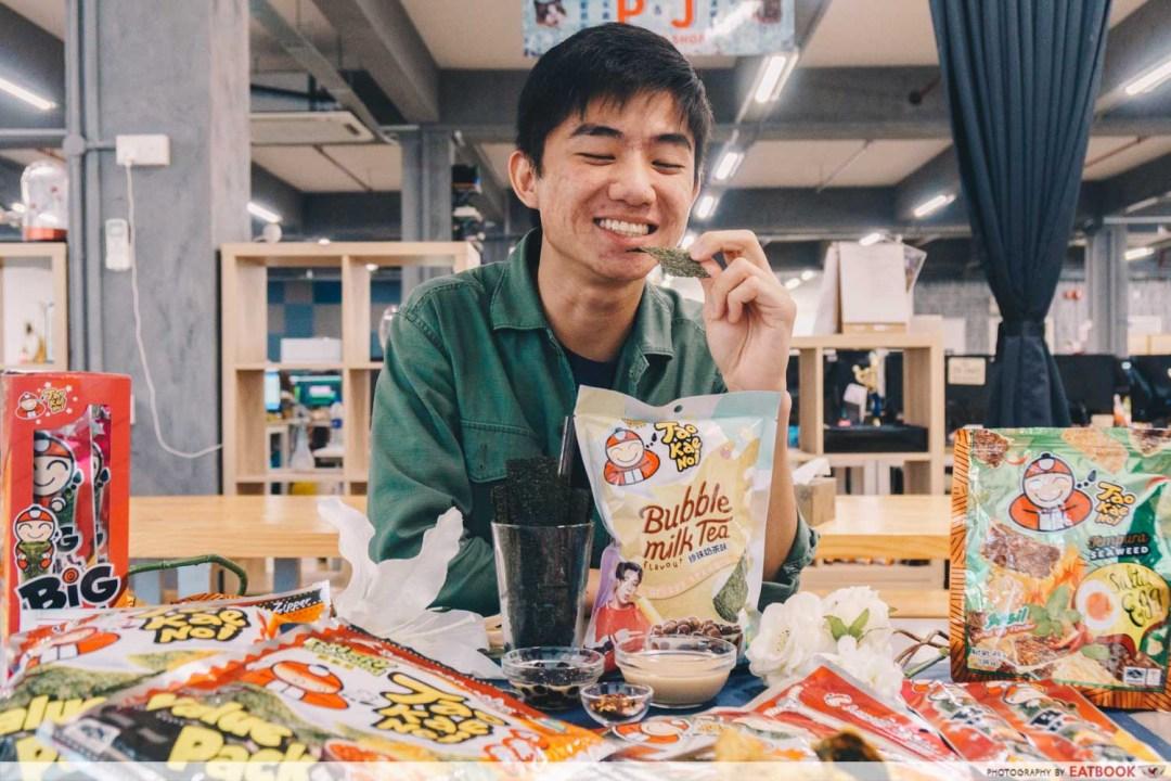 man eating snacks