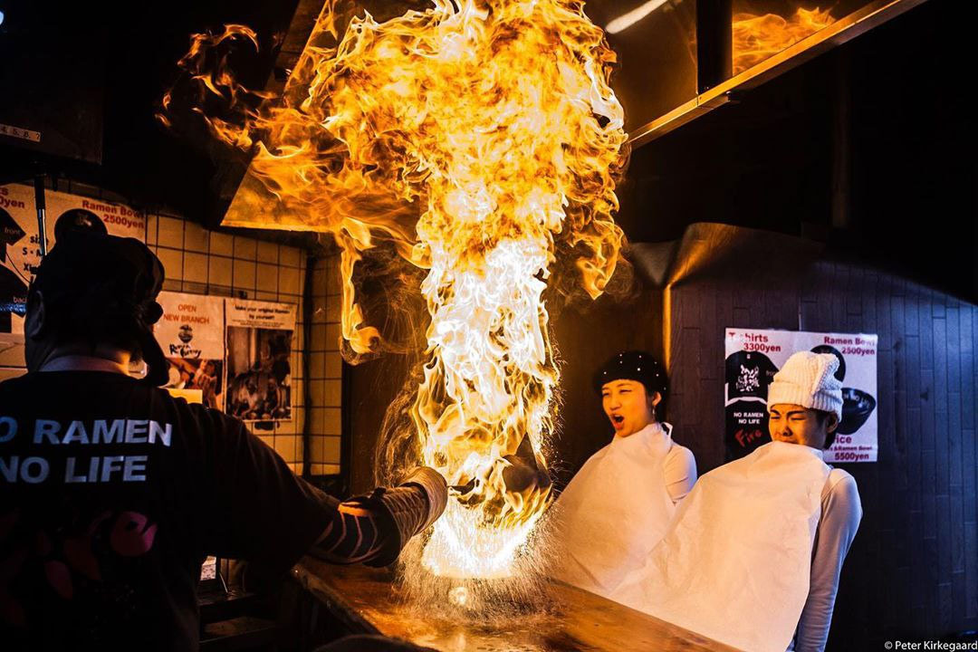 Menbaka Fire Ramen - Ramen on fire in front of diners