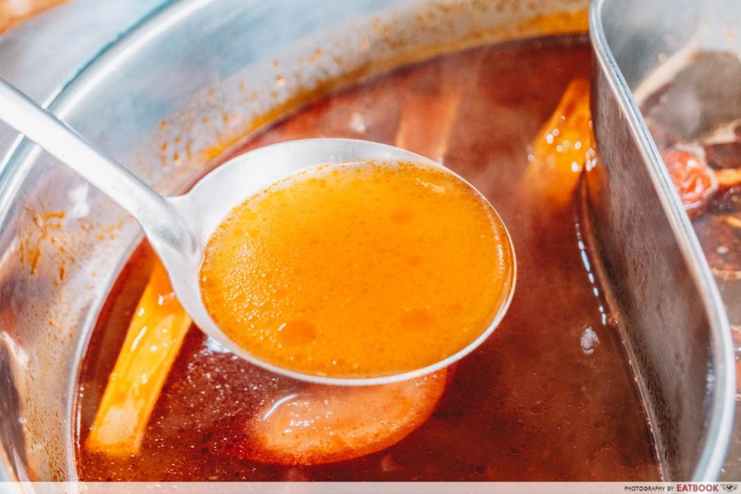 Yi Zi Wei - Tomato soup closeup