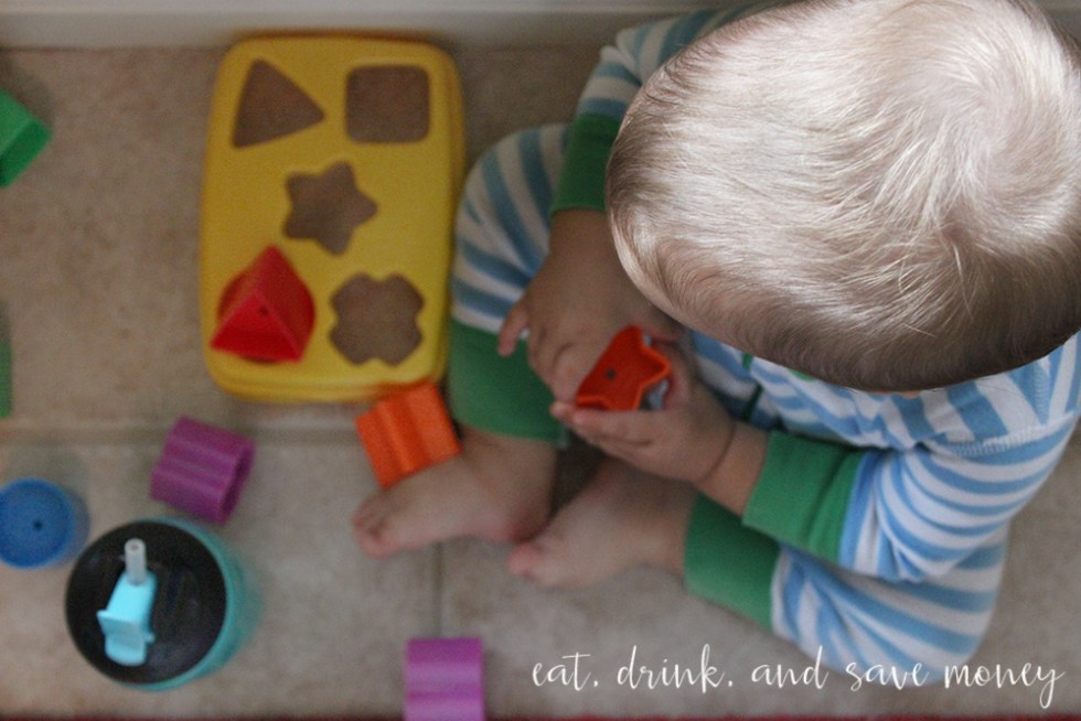 Jackson playing with toys and drinking his Gerber toddler drink