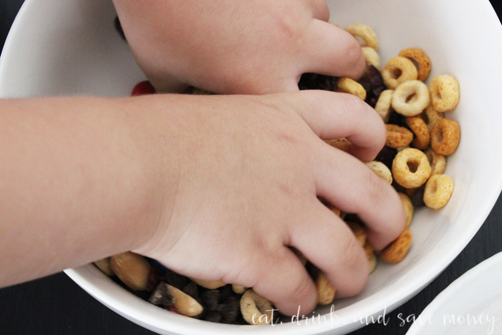 Mixing up the toddler trail mix with Cheerios