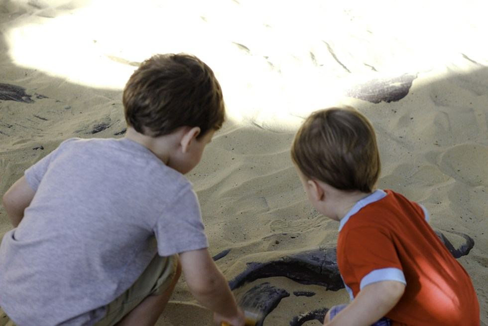 Family Activities in Orlando- Boys excavating bones at Dinosaur World