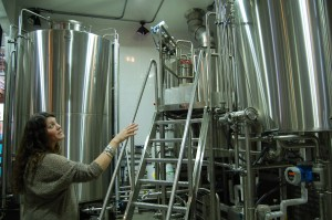 Ingraham shows one of four of The Post's fermentors. Photo by Rachel Dugas
