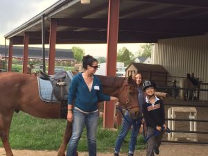 Send a Kid to Camp grant recipient Daniel Li attending the Colorado Therapeutic Riding Center's summer camp program